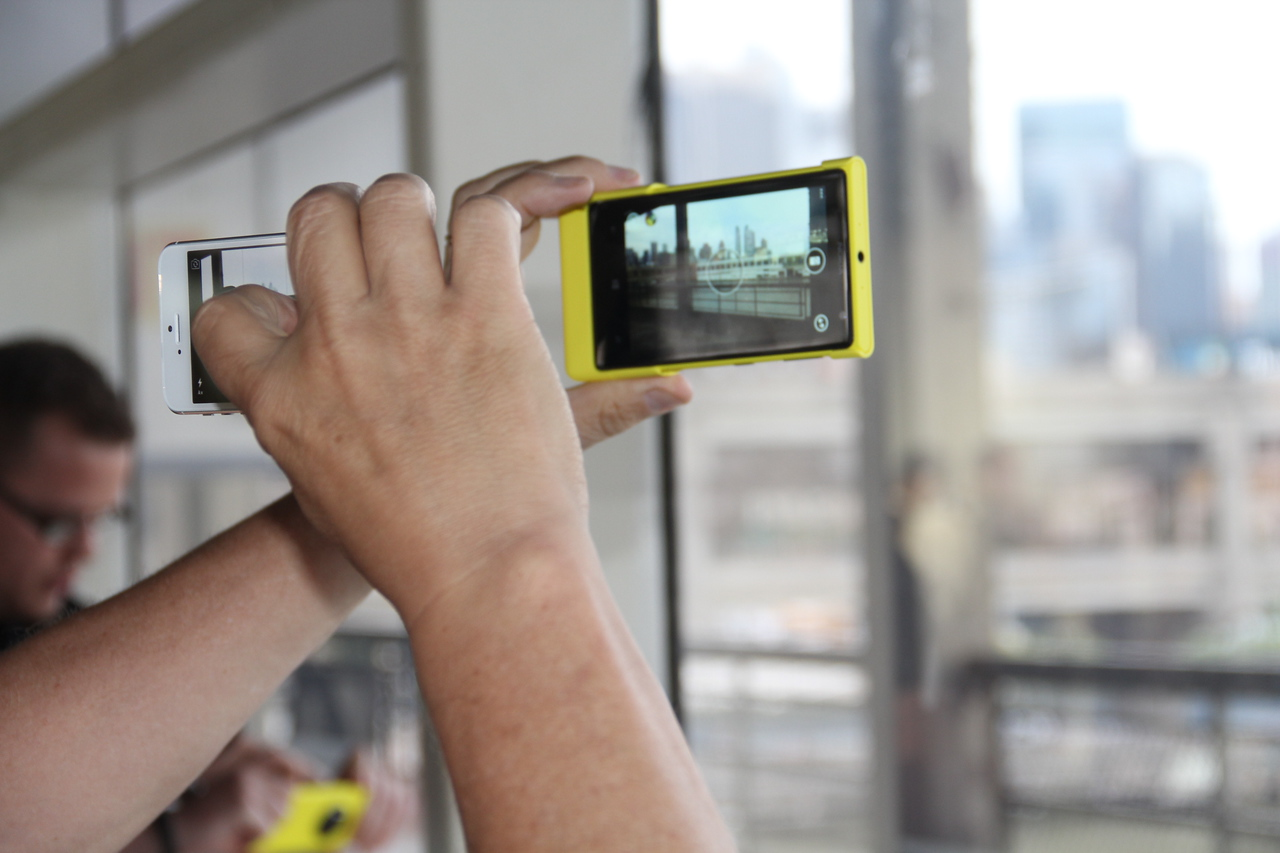An attendee captures a city-scape picture with the Lumia 1020.