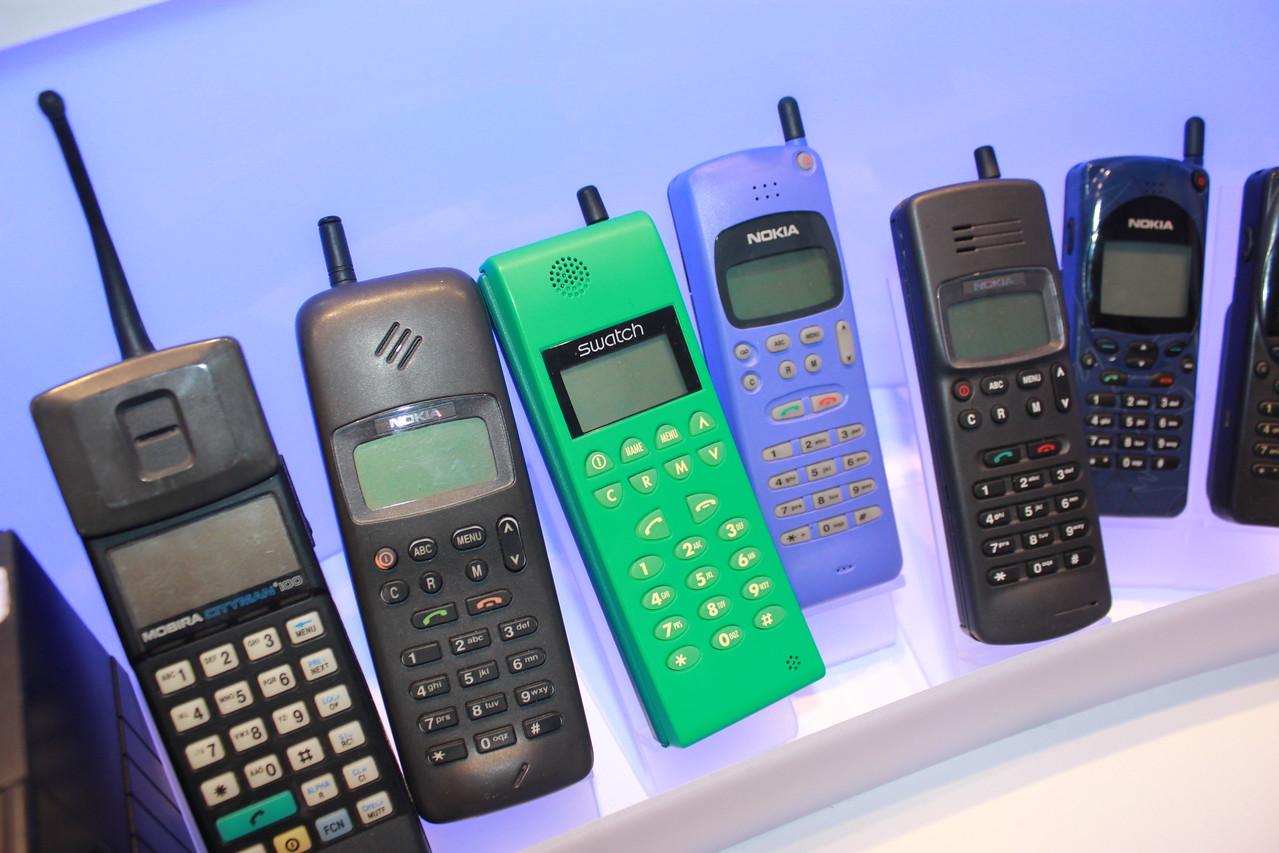 Various early phones, including a green Swatch-branded model.
