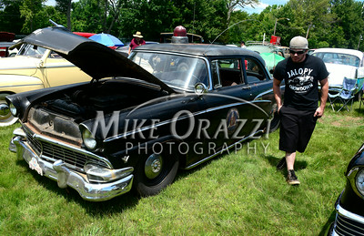6 /28/2014 Mike Orazzi | Staff Scott Balkow next to a Ford police car a the Rumblers Nomads Car Show at the Terryville Fair Grounds on Saturday morning.