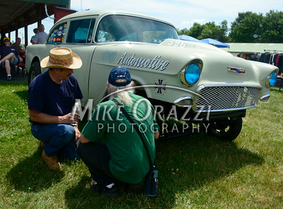 6 /28/2014 Mike Orazzi | Staff Brothers Fred and Lester Camire check out a 1956 Chevy during the Rumblers Nomads Car Show at the Terryville Fair Grounds on Saturday morning.