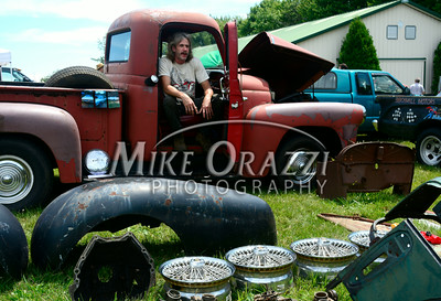 6 /28/2014 Mike Orazzi | Staff Rich Smith sits in his 1956 International pickup truck while selling auto parts during the Rumblers Nomads Car Show at the Terryville Fair Grounds on Saturday morning.