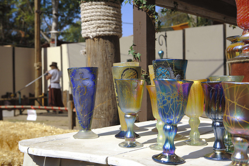Hand-blown glass goblets.  The glass blower is in the distance.  He's been doing this professionally for thirty seven years.  He seemed very knowledgeable on the chemical and physical properties of glass, in addition to being an excellent craftsman.  He even makes his own starting glass from silica sand.