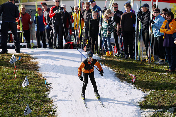 Record-Eagle/Keith King<br /> Spectators and racers look on as Spencer Todd, 11, of Grand Rapids, skis against the clock Saturday, October 22, 2011 on a course at Brick Wheels during the second annual Nordic Fest. The event includes a Vasa Ski Club membership drive and party as well as a cross-country  and telemark ski swap with the ski race being the U.S.A. Nordic, and Michigan Cup, cross country ski 2011-2012 racing season opener.