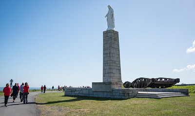 Memorial statue.  Behind it is a section of floating roadway from the harbor.