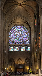"Looking across the Transept to the north.  ""Rose"" windows adorn each end of the Transept."