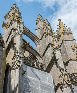 Flying-buttress arches outside the newer portion of the abbey church.  Extensive scaffolding in this area suggested a good deal of restoration in progress.