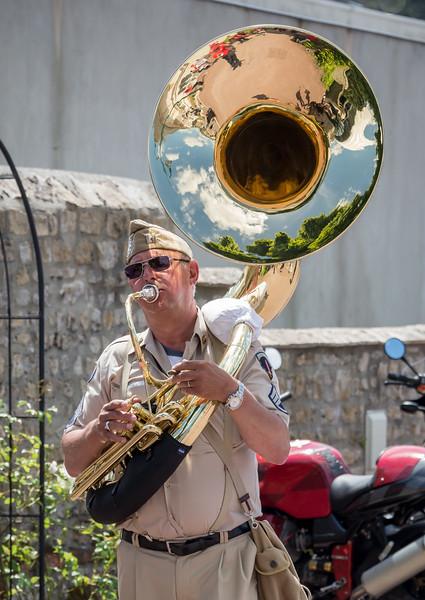 Multitasking:  playing Sousaphone while smoking a cigar!