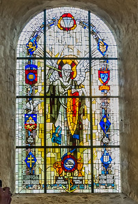 """This window depicts Saint Michael, patron saint of paratroopers. The 82nd Airborne Division, the lion of Normandy, the Sainte Mere Eglise insignia, and symbols for each of the combat jumps made by the 82nd Airborne Division during World War II are also represented.  It was donated by veterans of the 505th Parachute Infantry Regiment, 82nd Airborne Division, in 1972.   Inscription:  """"To the memory of those who through their sacrifice liberated Sainte Mere Eglise."""""""""""