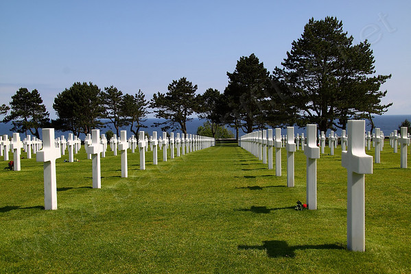 Graves in the Cemetery with Omaha beach in the distance
