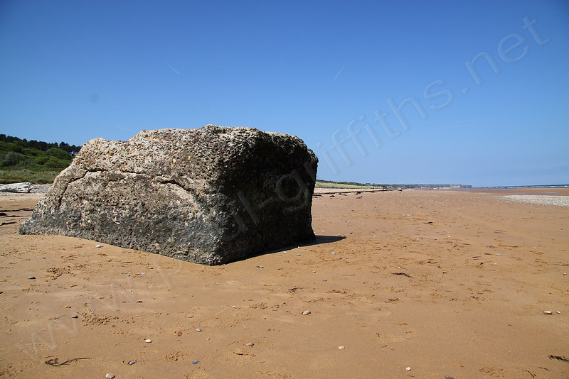 Some of the origainl beach defences are still there... intended to stop troops and tanks from moving up the beach on D-Day