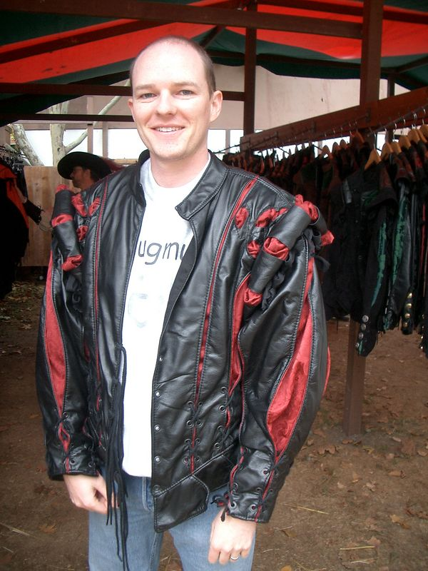 Don trying on a nice leather doublet