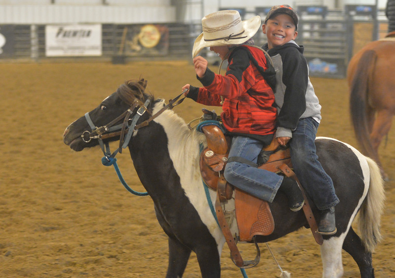 Justin Sheely | The Sheridan Press<br /> Eight-year-old Twister Fischer of South Dakota, left, and Brayden Fisher of Ashland, Montana, ride a pony prior to the performance of the Northern Plains Indian Rodeo regional finals Saturday at the Sheridan College AgriPark.