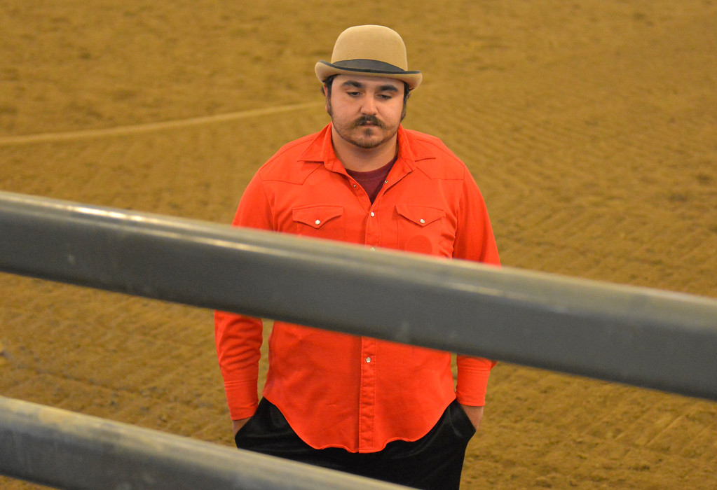Justin Sheely | The Sheridan Press<br /> Bullfighter Wazey Spang waits as preparations are made in the bucking chutes prior to the performance of the Northern Plains Indian Rodeo regional finals Saturday at the Sheridan College AgriPark.