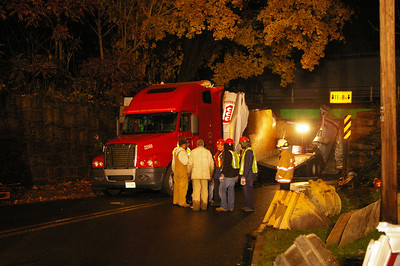 Tuesday, November 20th, 2007: The 21st truck to get stuck under the railroad bridge over route 183 actually pulled it's trailer completely through the underpass.  It was traveling southbound on route 183.  Here Cressona firemen and fire police assist with traffic as enviornmental workers assist with the cleanup.