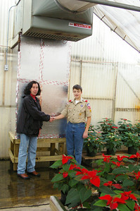 Wednesday, November, 21st, 2007:  Avenues Greenhouse Supervisor, Sally Morgan thanks Eddie Brennan, age 12, Schuylkill Haven for his part in rebuilding the heating system of the greenhouse.  Eddie constructed 4 wooden frames to support the ducts to heat the greenhouse.  This project was chosen by Eddie while he was working to earn the Disabilities Awareness Merit Badge.  He is a member of Schuylkill Haven Troop 625.  Avenues (formerly known as United Cerebral Palsey), operates a workshop to produce items to sell in the greenhouse and the giftshops.  It is located in the Agricultural Park area between Pottsville & Mechanicsville.