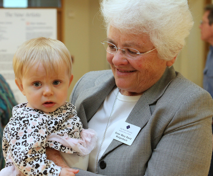 Ruth Grace held by Sister Mary David - she was in safe and loving arms all evening long.