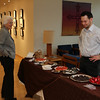 Sister Mary David reviews the fine chocolate selection offered by Robert Strohmayer, Store manager of Stam Chocolate.