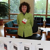 Nancy Sandleback, HWM staff displays photo cards from the NOW Exhibit.