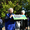 Sister of Charity Louise Akers speaks at a Nuns on the Bus rally. Precious Blood Sister Mary Wendeln, right, looks on.