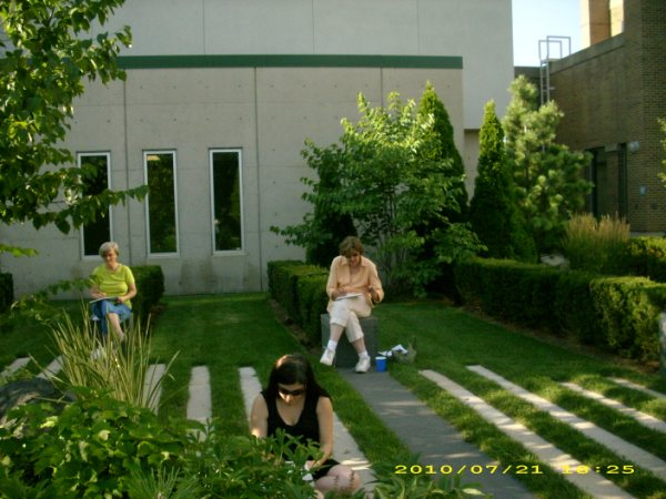 Participants sketch in the Healing Gardens at the Swedish Covenant Hospital on Chicago's north side.