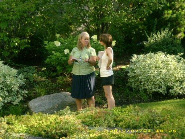 Presenter and Multimedia artist, LuEllen Joy Giera,  discusses the meditative qualities of sketching with another workshop participant in Swedish Covenant Hospital's Healing Garden