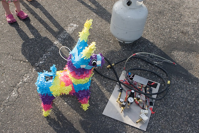 The pinata meets its fate - the propane-powered flame thrower to be controlled by the Flame Amp.