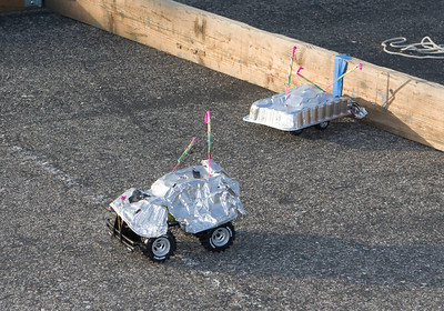 An RC car competition included several modest competitors (with heat protection) and the combat robot (with flame thrower).