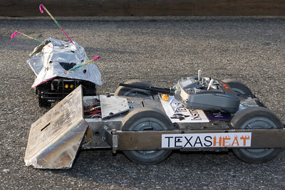 The competitors in the last RC car standing competition meet.  Note the festive decorations on the smaller car.