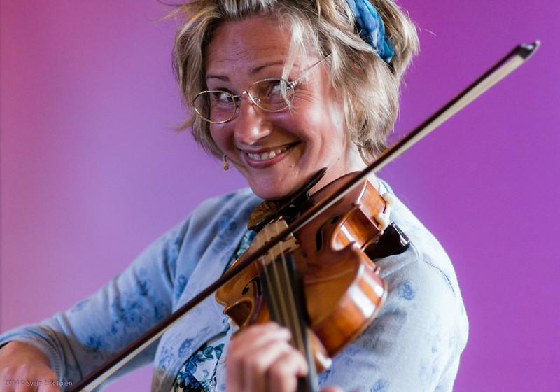 ...manic violinist playing Norwegian folk tune...