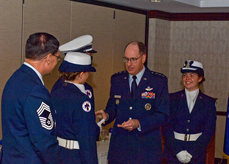 General Kehler presenting coins to Color Guard