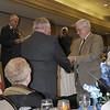 Bert Scanlan receiving Commander's Coin from Don Aldridge