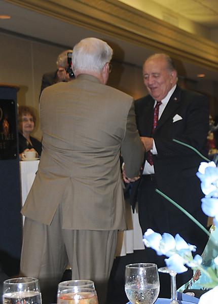 Chuck Helton receiving the Commander's Coin