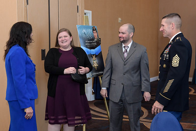 Vice Chief of Staff of the U.S. Army Gen. James C. McConville, Sergeant Major of the Army Daniel A. Dailey, and Mrs. Holly Dailey meet with the Shurer family prior to the Medal of Honor Reception at the Sheraton Pentagon City Hotel in Arlington, Va., Sept. 30, 2018. Shurer will be awarded the Medal of Honor Oct. 1, 2018, for actions while serving as a senior medical sergeant with the Special Forces Operational Detachment Alpha 3336, Special Operations Task Force-33, in support of Operation Enduring Freedom in Afghanistan on April 6, 2008.  (U.S. Army photo by Spc. Anna Pol)(U.S. Army photo by Spc. Anna Pol)