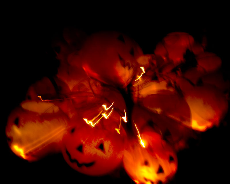 Pumpkins at Christmas light abstracts.