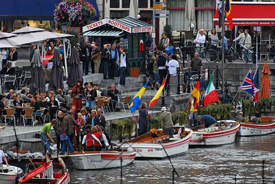 Environment picture, captured at OdeGand 2008 that is all about music and 'water', featuring music performances on or around the river Leie in the city of Ghent (Gent), Belgium. Even on an overcast and rainy day, there were many spectators and visitors.
