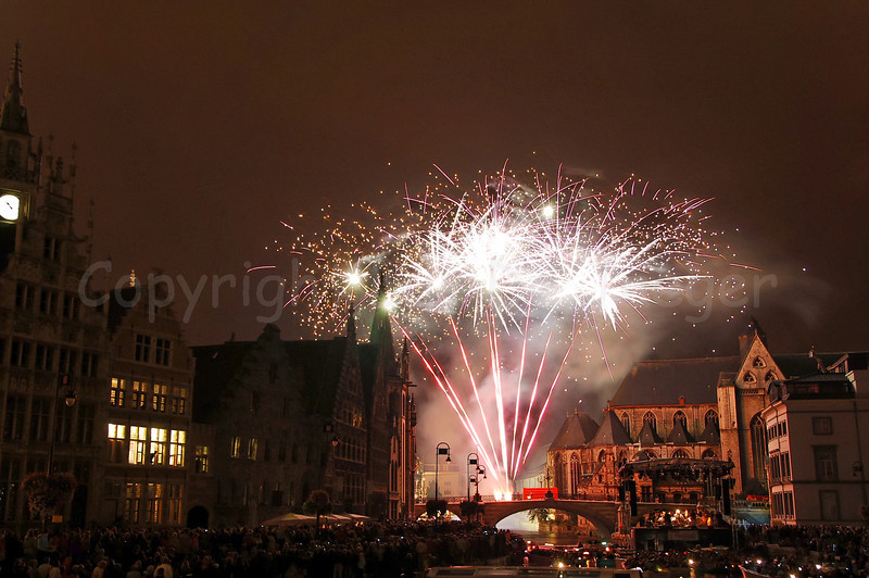 Fireworks, shot from the St Michielsbrug (St Michael's bridge), end the OdeGand festivities in Ghent (Gent), Belgium.