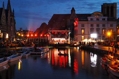 A view on the atmosphere and the floating podium/stage on the river Leie before the late evening spectacle begins during the 2010 OdeGand festivities in Ghent (Gent), Belgium.