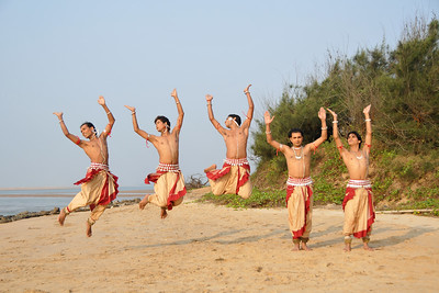 Male Odissi dancers jump in the air during their shoot at the Konark beach close to the famous Konark Sun temple.  These dancers have been mentored by the renowned Odissi dance teacher Guru Gangadhar Pradhan who unfortunately passed away last year. For more details on the festival and the organizers, take a look at:  http://konarkfestival.com/ and  http://www.konarknatyamandap.org/