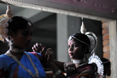 Girls helping each other in getting ready for the evening events.  The Konark Dance & Music Festival 2011 held from February, 19th to 23rd, organized by Konark Natya Mandap. The festival takes place in an open-air auditorium and enlivens the spirit of the sculptures of Konark temple which is just a short distance away.  The objectives of the Konark Natya Mandap are to preserve, promote, and project the rich cultural heritage of Orissa and to infuse cultural awareness in the minds of all. Started with painstaking efforts of internationally renowned Odissi dance teacher Guru Gangadhar Pradhan who unfortunately passed away last year. For more details on the festival see  http://www.konarknatyamandap.org/ and http://konarkfestival.com/