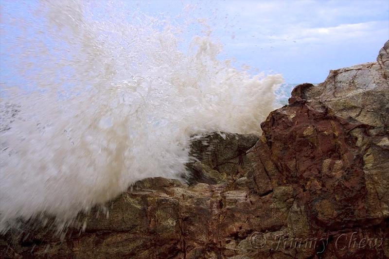 Waves pounding the rocks.