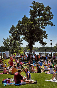 Dozens of families enjoy a free, family musical event called, 'Kids Koncert' on a stellar Summer afternoon at the Parkers Lake Park Stage in Plymouth Wednesday, Aug. 17, 2011.  The 45-minute Bluegrass concert by the nationally renown local band, The Okee Dokee Bros., was a perfect way to spend an afternoon.