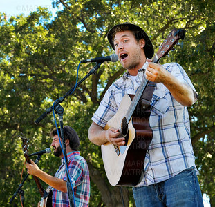 The Okee Dokee Bros. are Justin Lansing on banjo, left, and Joe Mailander on acoustic guitar.  The local Bluegrass band played a free,  45-minute set for dozens of families at the Plymouth park Wednesday, Aug. 17, 2011.