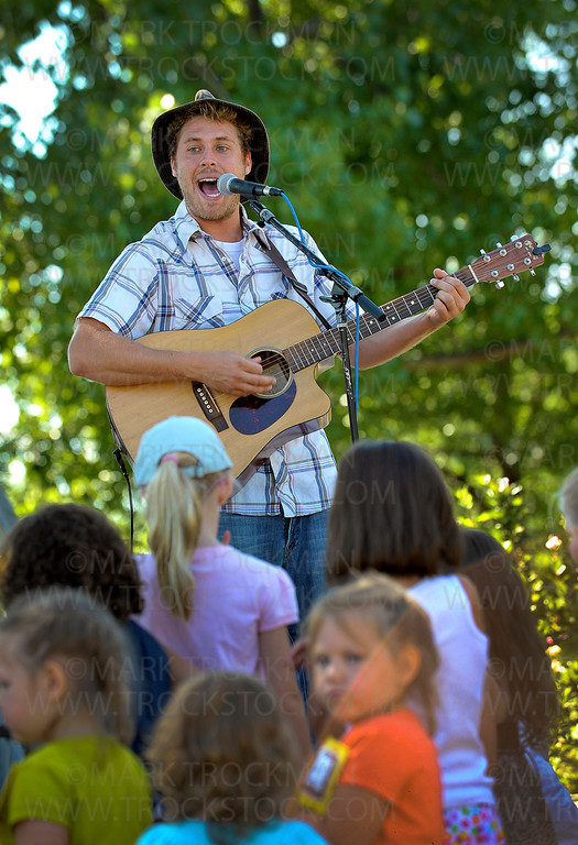 Okee Dokee Bros. band member Joe Mailander plays acoustic guitar and sings Bluegrass tunes on the Parkers Lake Park Stage in Plymouth Wednesday, Aug. 17.