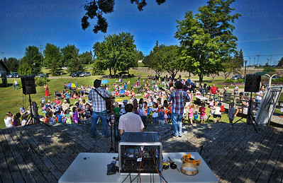 A view of the Okee Dokee Bros. playing their free 'Kids Koncert' for dozens of families from Parkers Lake Park Stage Wednesday, Aug. 17, 2011.