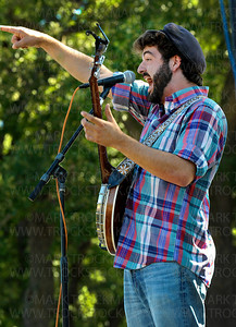 Okee Dokee Bros. banjo player Justin Lansing sings Bluegrass tunes on the Parkers Lake Park Stage in Plymouth Wednesday, Aug. 17. Bluegrass tunes of the Okee Dokee Bros. band at Parkers Lake Park Stage in Plymouth Wednesday, Aug. 17.  The 45-minute 'Kids Koncert' set included dozens of children performing different types of dancing and musical feats at the free, family event.