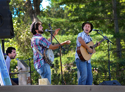 The Okee Dokee Bros., left to right, Jed Anderson on the Cajon, a box drum, Justin Lansing on banjo and Joe Mailander on acoustic guitar, played a free, 45-minute family event dubbed, 'Kids Koncert,' Wednesday, Aug 17, on Parkers Lake Park Stage.