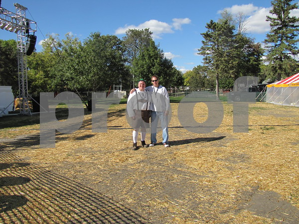 Jim Reed and Bill Rodewald, promoters of Oktoberfest, stand in the area where the evening concert goers will congregate.