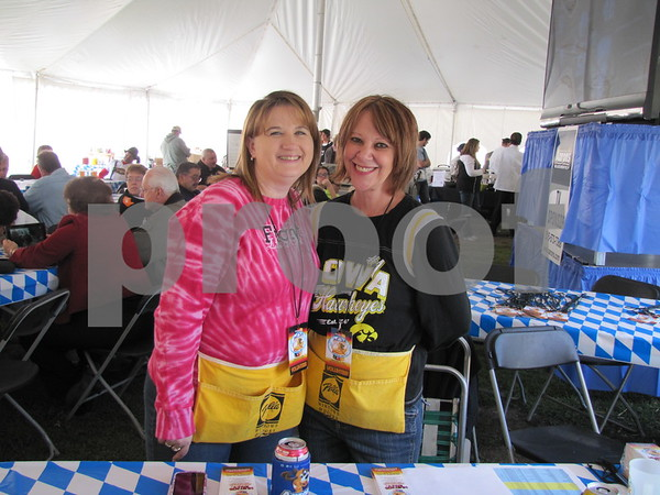 Melissa Hansen and Joyce Bickford took tickets to the Oktoberfest at Oleson Park.