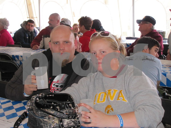Jon Meek and Kala Gudbaur enjoy the Hawkeye game at Oktoberfest.