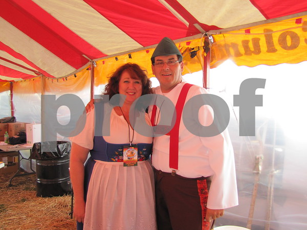 Cheryl Sherry and Tim Wilson work the beer tent at Oktoberfest.